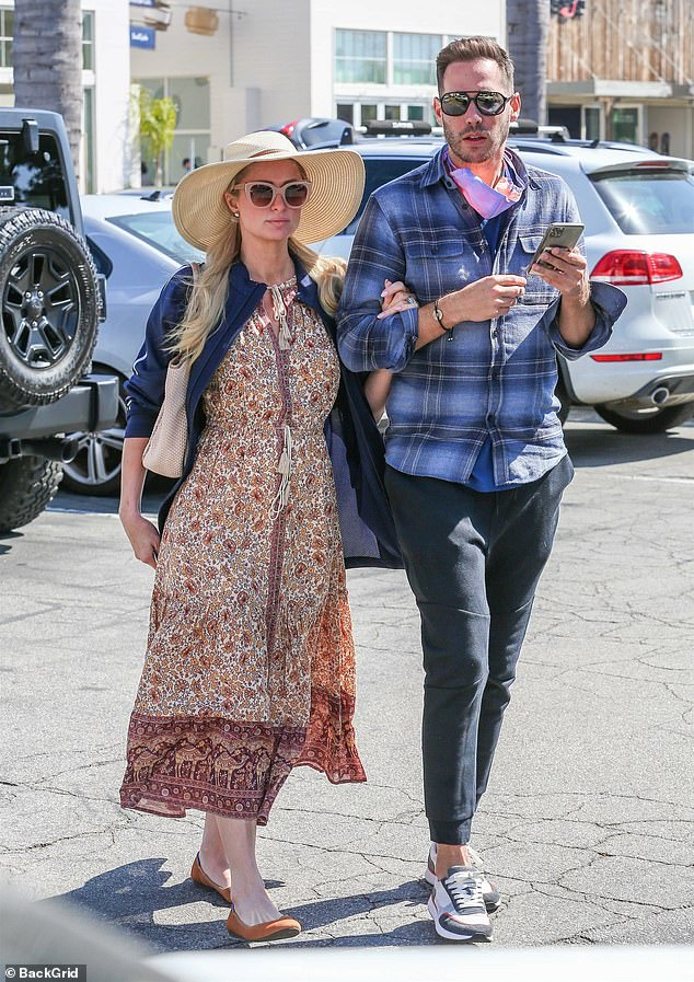 Loved: Paris Hilton, 40, couldn't keep her hands off her fiance Carter Reum, 40, during a shopping spree in Malibu on Saturday