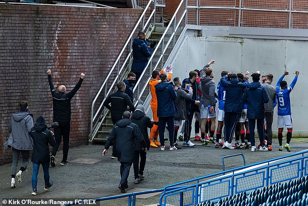 Rangers players ran to the corner of Ibrox Stadium to celebrate with fans outside the ground