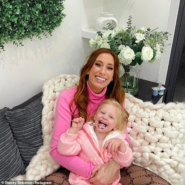 Affectionate mother: Stacey Solomon wore a pink sweater as she stood in touch with youngest son Rex in an Instagram post she shared on Saturday