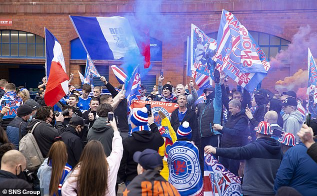 More and more Rangers fans gathered outside Ibrox on Sunday as celebrations went on
