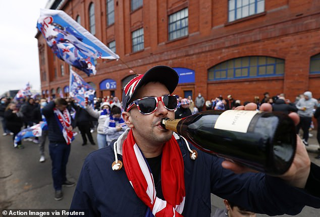 It was time for the champagne to be uncorked as Rangers drew a line under a decade of misery
