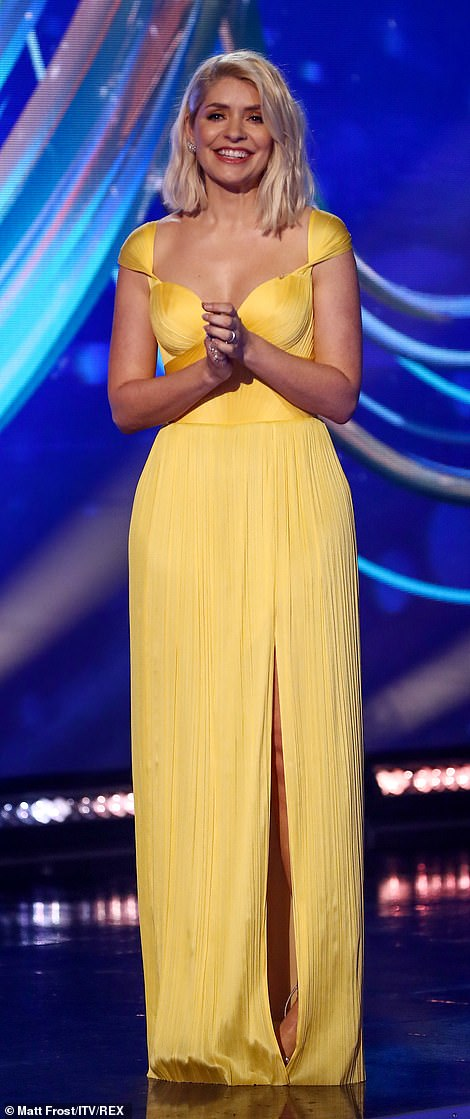 Elsewhere: Presenter Holly Willoughby was sure to command attention in a plunging yellow chiffon dress featuring a daring thigh split along the skirt