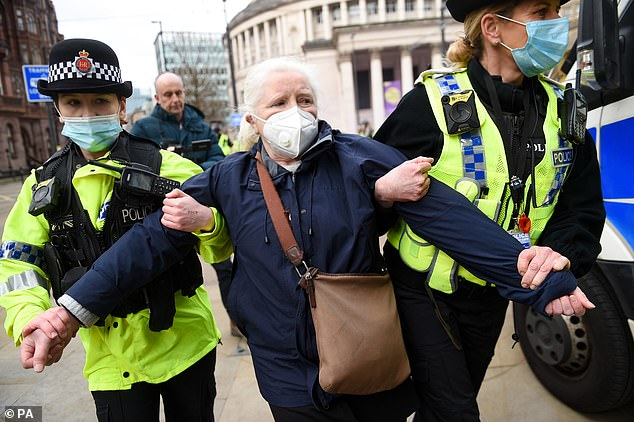 Police detain an NHS worker after breaking up a protest in Manchester earlier today