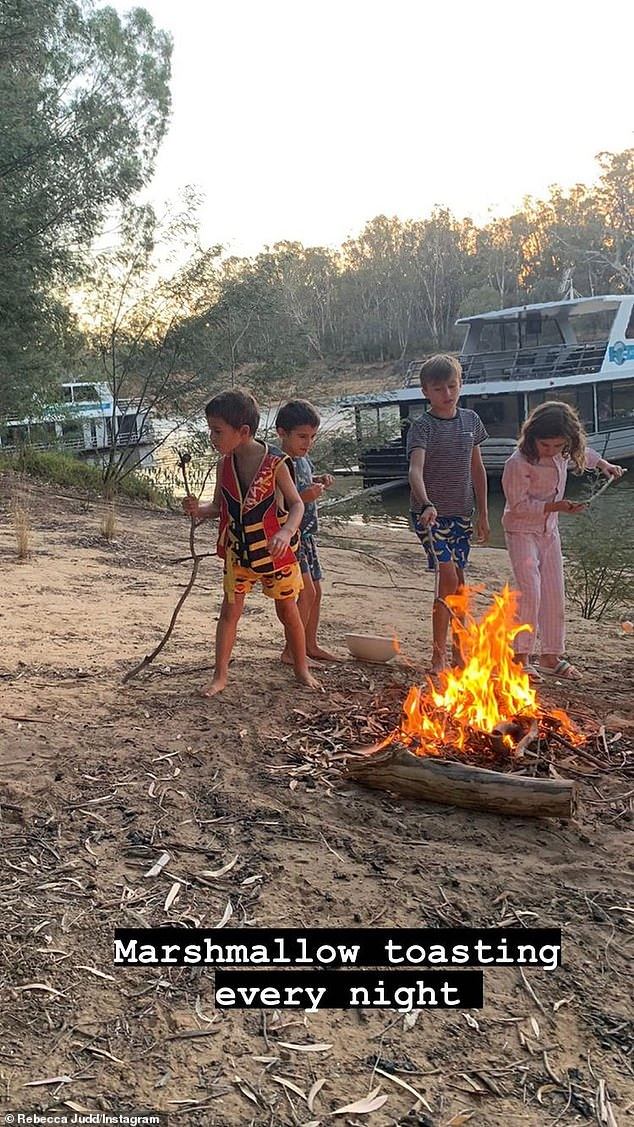 Cozy: As night fell, the four kids enjoyed a bonfire on the beach and Bec explained that they enjoyed a `` marshmallow toasting every night. ''