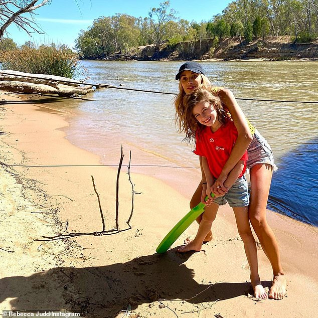 Magnificent!  The model joined her daughter Billie for a game of cricket on the sand, with sticks found nearby for the wickets