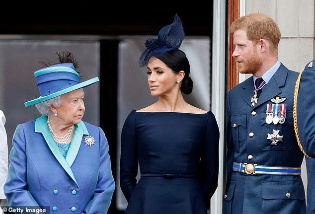 The Queen, Meghan and Harry stand together at Buckingham Palace on July 10, 2018
