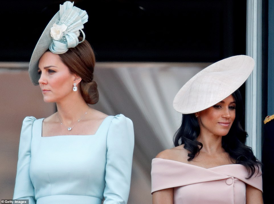 The Duchess of Cambridge (left) and the Duchess of Sussex (right) stand on the balcony of Buckingham Palace in London during Trooping The Colour on June 9, 2018