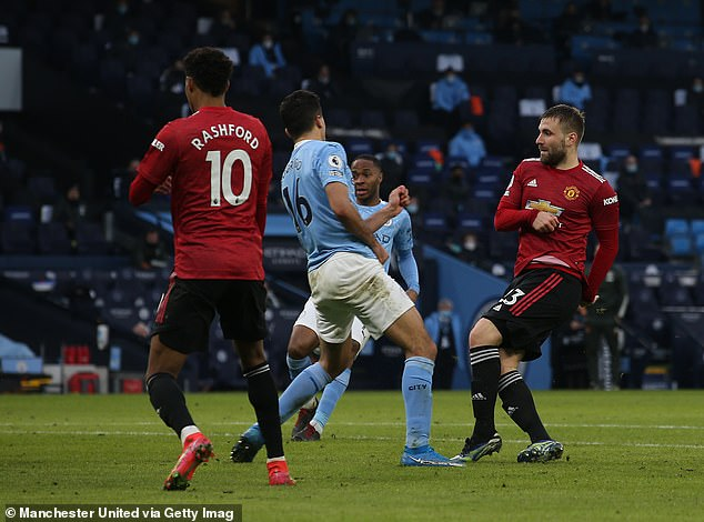 Shaw (right) scored United's second goal in a surprise 2-0 victory over rivals City on Sunday