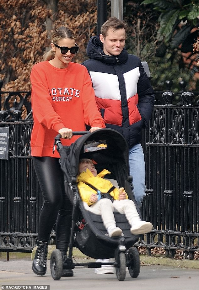 Family outing:Vogue Williams made time for a family outing as she stepped out on a stroll with her son Theodore, two, and her younger brother, Alexander Wilson, in London on Monday