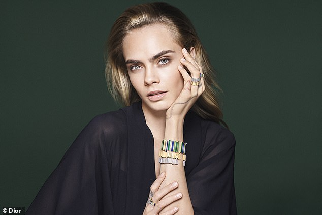 Influence: For a separate look, Cara decorated her slender fingers and cuffs with other jewelry from the collection, inspired by natural minerals