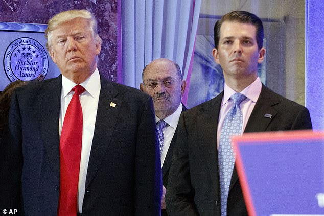 Trump's longtime accountant, Allen Weisselberg, (pictured in the background) faces pressure to turn on Trump in the criminal probe. They are pictured in 2017