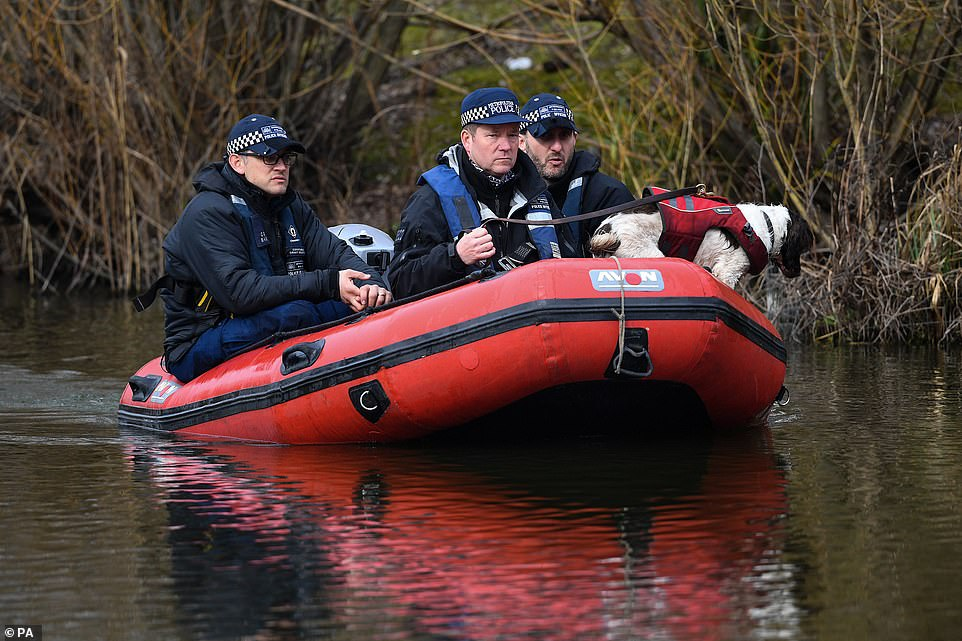 This is the second day in a row police officers have headed out in a boat with a sniffer dog to search bodies of water for clues