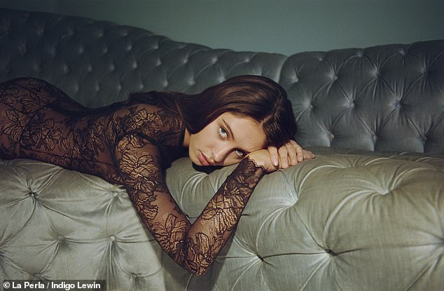 Beauty:Iris also rocked a statement £440 lace jumpsuit as she lounged on a sofa during the 80s archive collection shoot