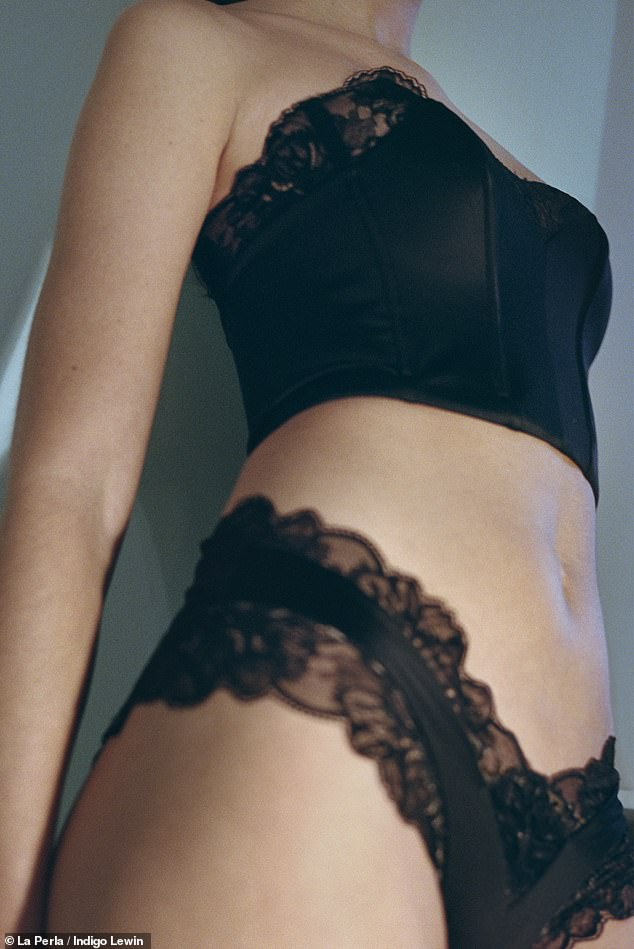 Racy: She set pulses racing in another lingerie look of lacy pants and a structured corset top