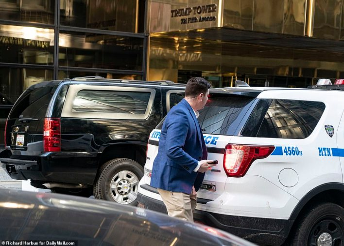 On Tuesday, NYPD vehicles and secret service surrounded the building ahead of Trump's departure