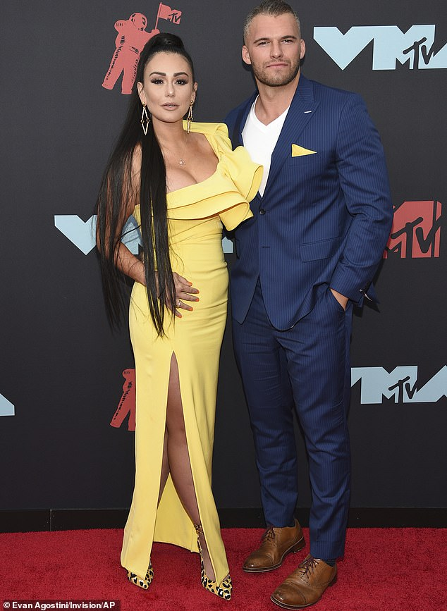 Hot couple: JWoww has gushed on Jersey Shore thatZack was 'a f***ing monster in bed' to the point she once said to him: 'Are you an escort? What's going on?'; pictured in August 2019