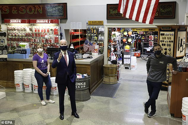 Biden used his visit to W.S. Jenks & Son on Tuesday to knock former President Donald Trump 's administration for doling out PPP loans to 'people who shouldn't have gotten the help'. He is seen speaking to co-ownerMike Siegel (right) andMary Anna Ackley (left), who owns one of the two urban farms in the building