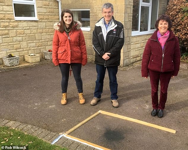 Hannah Wilcock, 25, and her parents,Cathryn and Rob, discovered the meteorite outside their homein Winchcombe last month after it marked their driveway