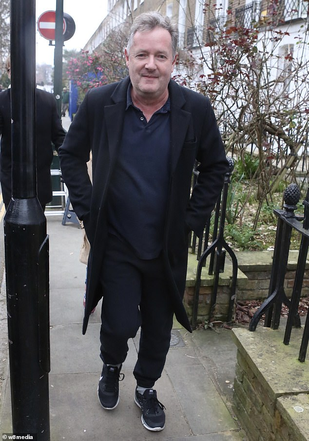 Piers Morgan laughs as he leaves his West London home today after quitting GMB in a row sparked by his comments about not believing Meghan Markle