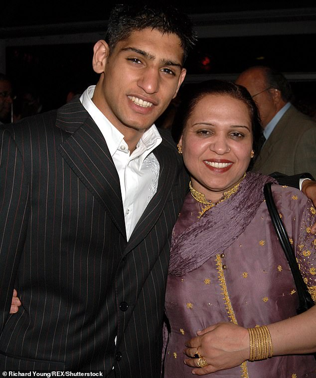 MailOnline was told by Khan's father that the former boxing champion got his vaccine after expalining to his doctor he was visiting his mother, Falak, 54, who has pancreatic cancer