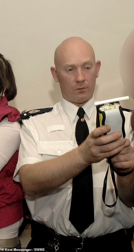 Wayne Couzens early in his career doing a breathalyser test