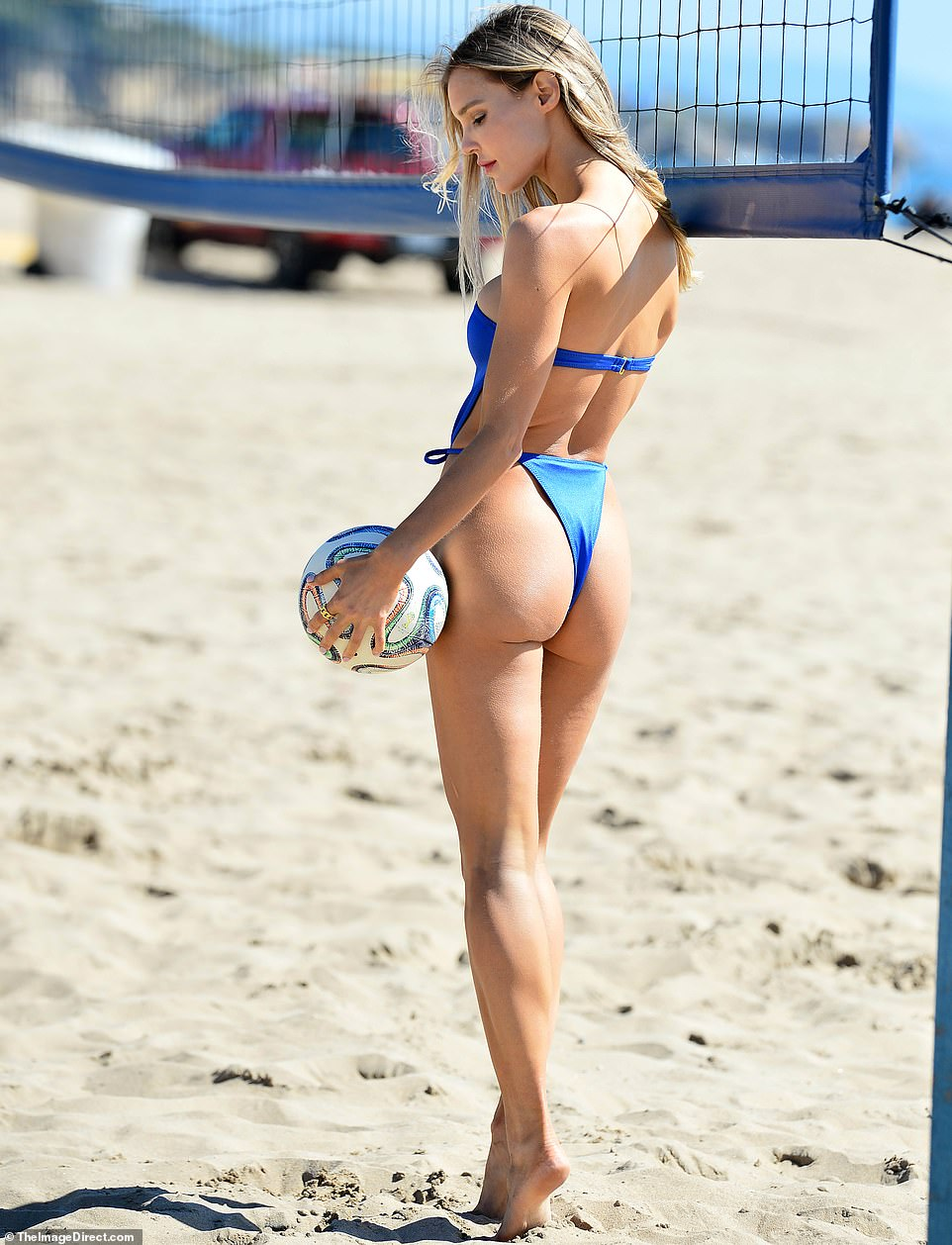 Looking fab:\u00A0The 33-year-old slipped into a strapless true blue swimsuit that hinted at her cleavage and played up her derriere