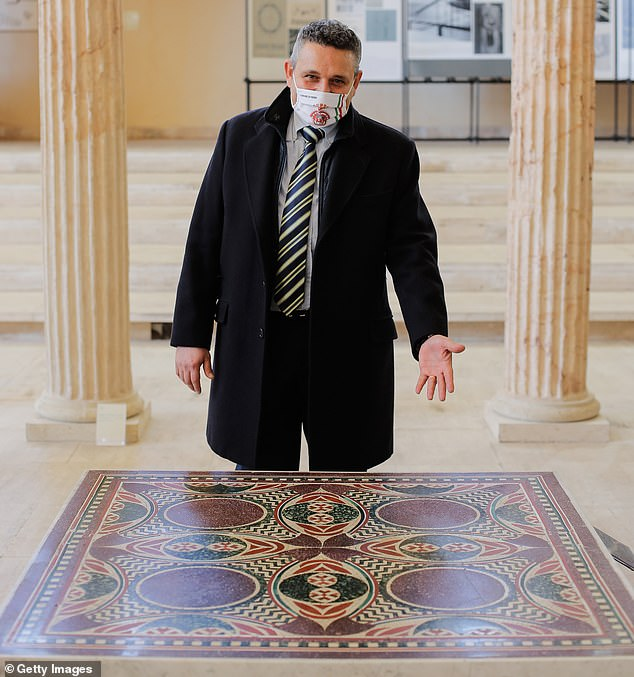 'The mosaic testifies how important and luxurious these imperial ships were,' mayor of Nemi Alberto Bertucci (pictured here with the table) said at he said at the unveiling on Thursday ¿ adding that the city was proud to be welcoming the mosaic back home