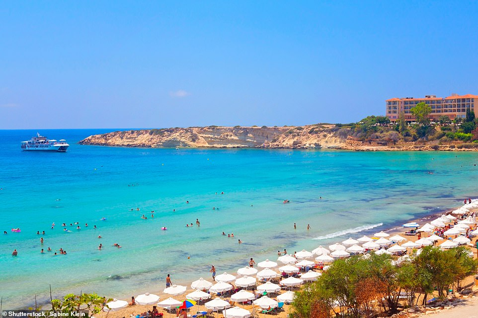 Soak up the sun: Coral Bay near Paphos (above) is known for its golden sandy beaches and sea caves