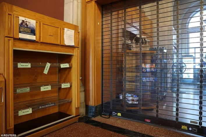 A shuttered news stand sits empty inside the New York State Capitol, following allegations that Gov Cuomo had sexually harassed young women
