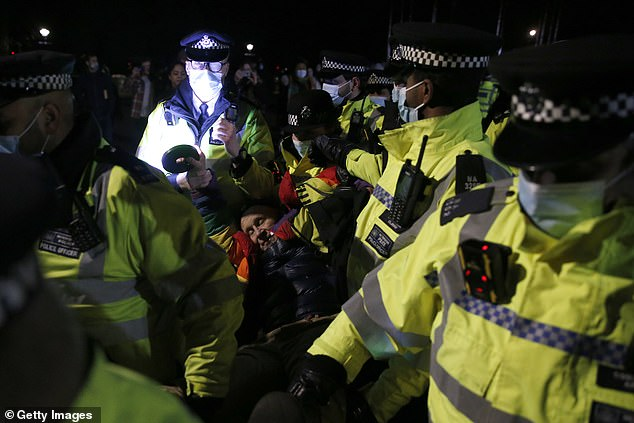 Officers have been blasted for using heavy-handed tactics critics dubbed 'quasi military'.Pictured: Police arresting a demonstrator