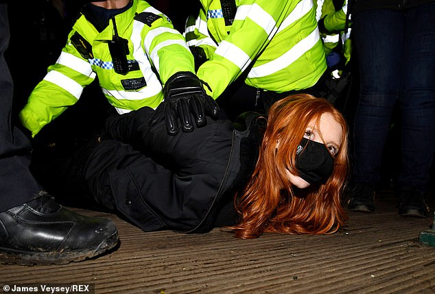Crowds of mourners started chanting 'arrest your own' and 'shame on you' as scenes quickly turned violent. Pictured: A woman being arrested