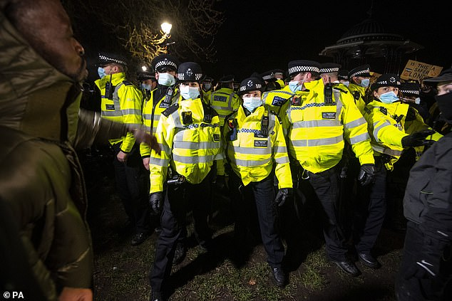 Witnesses said women were 'elbowed in the face' by police for helping others off the ground - with one reportedly left bleeding. Pictured: Police at the scene