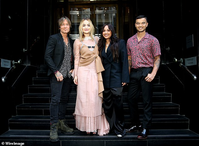 New stint: The songwriter is currently spending time Down Under as she kicks off her role as a judge on The Voice (pictured last month with Keith Urban, Jessica Mauboy and Guy Sebastian)