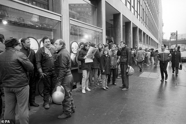 Workers are pictured outside Fleet Building in London in 1987 when 117,000 engineers went on strike