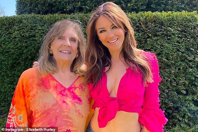 Tight: The Hurleys are very close, with Liz previously revealing her mum Angela had moved into her Herefordshire mansion so they could spend lockdown together (pictured together)