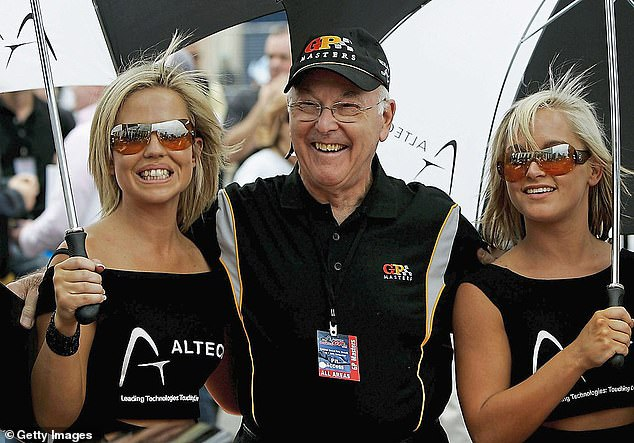 Walker picturedenjoying the glamour of motor racing