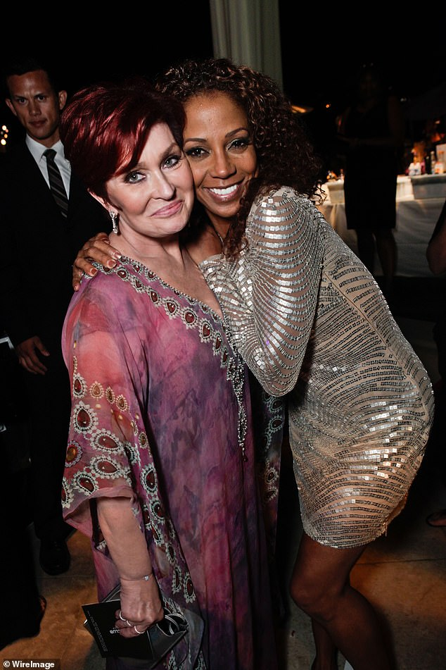 Sharon Osbourne, left, and Holly Robinson Peete, right, pictured in 2011. Osbourne has denied calling Holly Robinson Peete 'too ghetto' for The Talk, saying she 'never uttered those words' after CBS launched a probe into her bust up with Sheryl Underwood over Piers Morgan