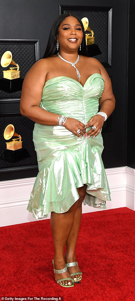 Going retro: Singer Lizzo gave serious '80s prom vibes in a shimmering strapless Balmain dress with flounce trim