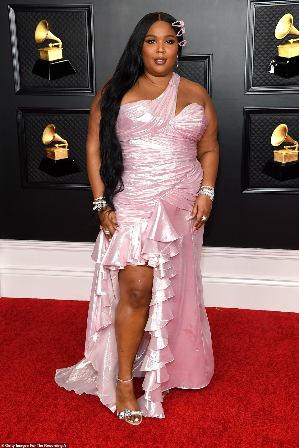Blush: Lizzo later changed into a pastel pink dress in a similar style but floor-length