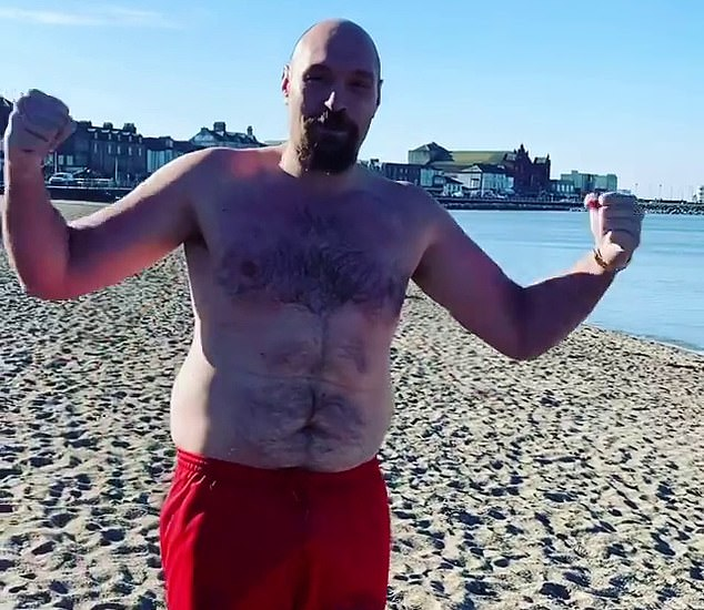 Fury poses at Morcambe Bay earlier this year as he waits for his fight with AJ to be confirmed