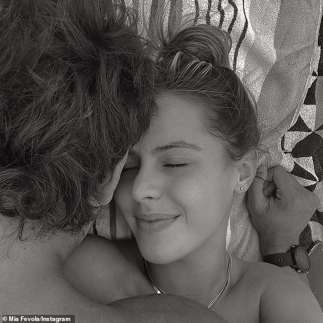 Sweet:The 21-year-old posted this romantic black and white image of herself cuddling up with Jamarra, then 18, in March.The innocent photo, which was captioned with a simple heart emoji, was soon swamped with vile abuse from trolls