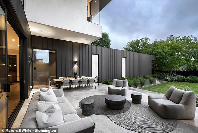Spacious:The stunning three-storey home is perfect for entertaining and features a grand entrance hall, library, home office and a five-car garage and gym