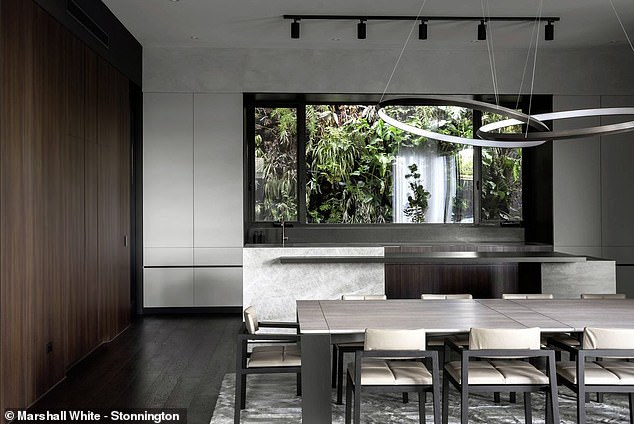 Lovely:The existing home was torn down and replaced with a 'masterpiece of modern design', according to the listing, created by Wolf Architects