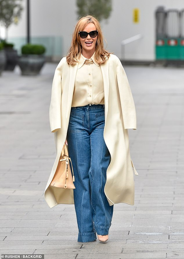 Fashion: The presenter also sported a pair of blue jeans while she added height to her frame with a pair of peach heels