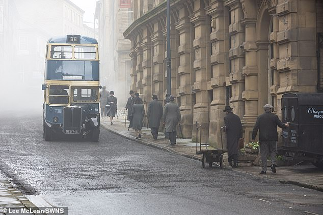 Eery:Meanwhile extras were dressed into their own period attire as they strolled down the street, which had been filled with smok by crew members