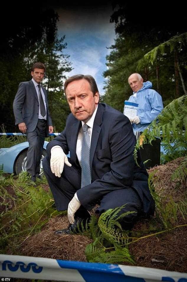 Exciting: Neil Dudgeon (centre) surprised Holly by saying:'We've all had a big talk about who we want to appear on Midsomer, and we decided we want Holly Willoughby'