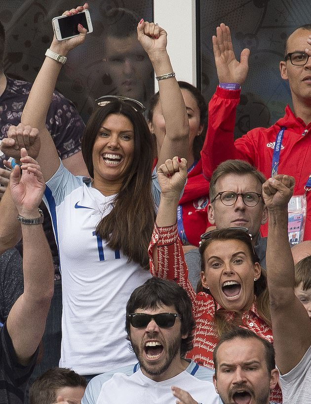 Memories: Coleen and Rebekah are seen as they celebrate England's win against Wales at Stade Bollaert-Delelis in France