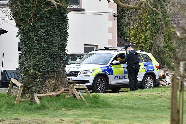 A police car outside a property in Newtownabbey, a\u00A0town north of Belfast, yesterday