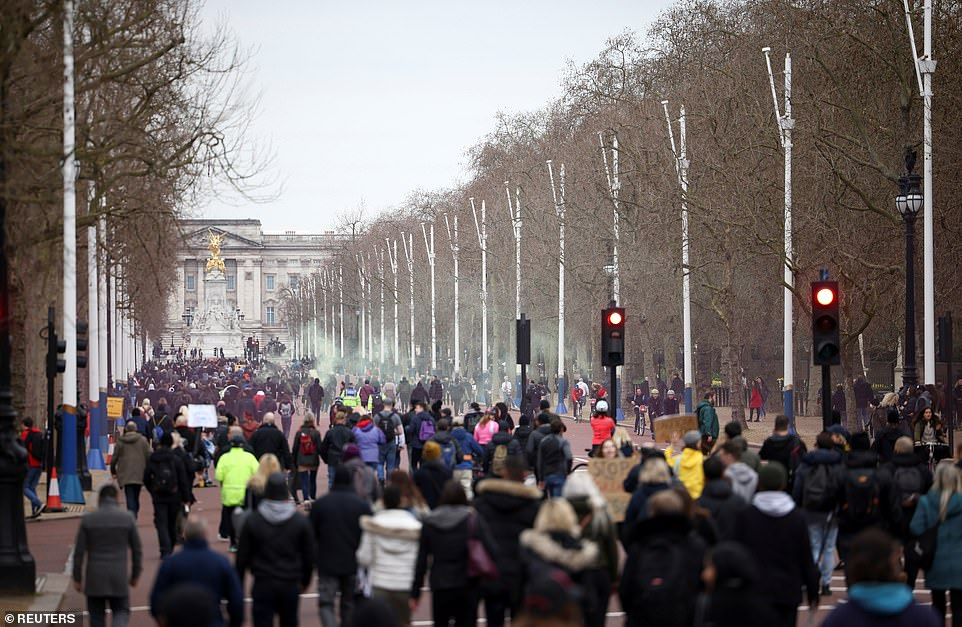 Protesters march through St James's Park up to Buckingham Palace during the anti-coronavirus lockdown demonstration in London today