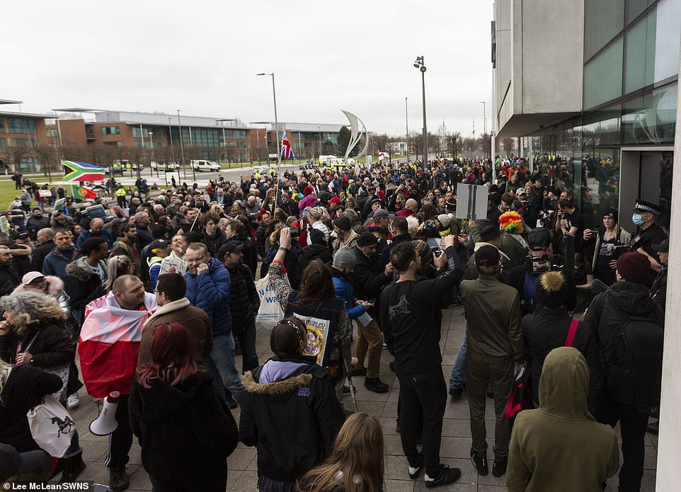 Protesters swarm around Greater Manchester Police HQ this afternoon.u00A0They carried with them police reports outlining the 'crimes the government are committing' and expect the force to process each report individually